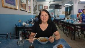 Lisa eating Khao Soi