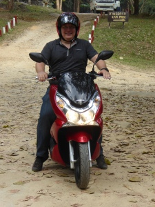 Robert driving scooter in Chiang Rai