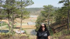 Lisa standing in front of fields in Dalat