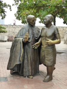 Creepy priest and slave statue